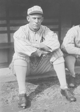 John F. Shano Collins sitting on the edge of the Chicago White Sox dugout in 1917. Photo was taken