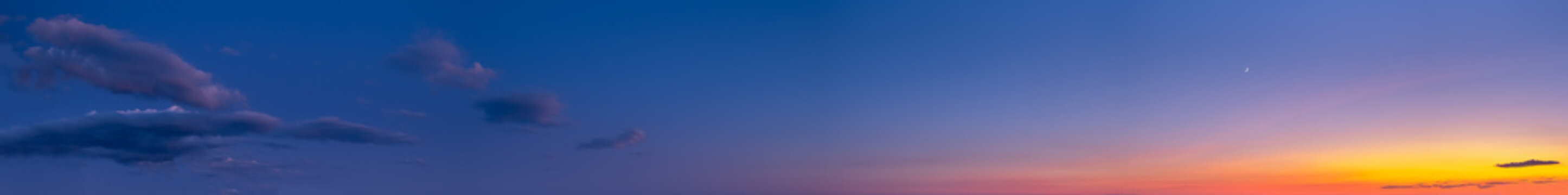 Night after sunset sky with clouds, stars and Moon (wide background panorama).