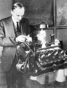 Henry Ford inspecting his new 'v-8' motor. ca. 1932