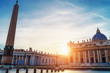 Saint Peter basilica in Vatican or Basilica Papale di San Pietro in Vaticano Rome, Italy at sunset in warm autumn evening. Fotomurales