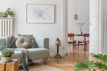 Stylish scandinavian living room and dining room with design mint sofa, mock up poster map, plants...