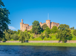 Inverness Castle sitting on a cliff overlooking the River Ness in Inverness, Highlands of Scotland.