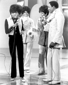 The Supremes (Diana Ross, Mary Wilson, Cindy Birdsong) talk with Paul Williams of The Temptations on a Motown television special, 1968