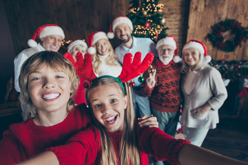 Self photo of large family meeting together with couple of brother sister taking selfie on...