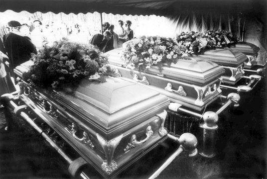 High school classmates of Nancy and Kenyon Clutter, look on their caskets and their parents who were slain in their farm home, Garden City, Kansas, 1959