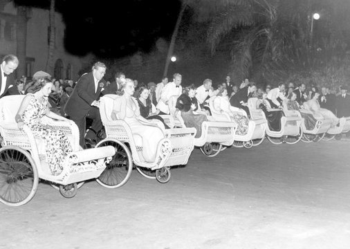 Fashionable members of the younger winter set at Palm Beach, Florida, lined up at the Everglades for the start of the annual Wheel Chair Derby
