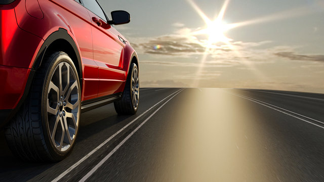 3d car sedan rides on the road to meet the sun, 3D rendering. Wheel close-up.