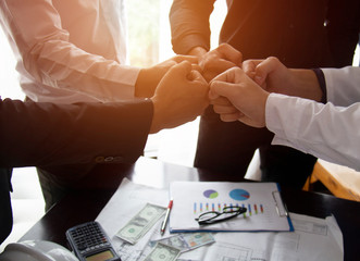 Teamwork Join Hands Support Together Collaboration Concept.Young Asian business people show symbolic hand for promised purpose to achieve the goal.