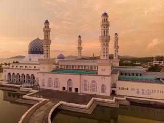 Aerial Drone image of beautiful mosque and the most famous tourist spot Likas Mosque(Masjid Bandaraya Likas), Kota Kinabalu, Sabah, Malaysia. during Sunset Fototapete