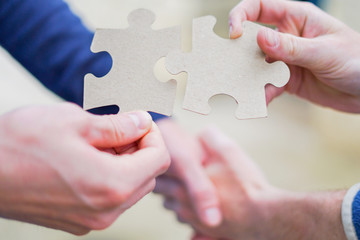Cooperation puzzle partnership and handshake teamwork in business group team company.