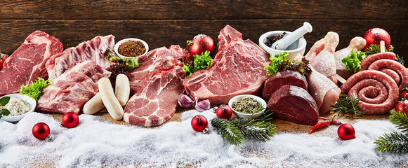 Panoramic view of variety of meat in winter Wall mural