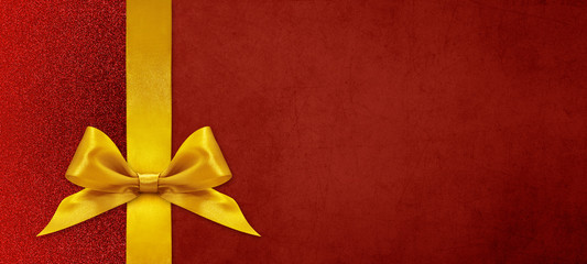 christmas gift card with golden ribbon bow on red background, copy space template