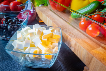 Preparing Greek salad. Greek salad recipe. Fast and tasty dish. Garnish. Snack. Salad with fresh vegetables and cheese. Mediterranean diet.