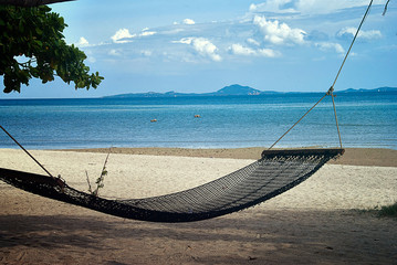 Autocollant pour porte Bali Hammock hanging between two trees on a beautiful Thai island. A relaxing holiday landscape