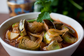 Ragout with artichoke, mushroom and potatoes served in bowl