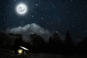 Wall Mural - The moon shines over the manger of christmas of Jesus Christ.