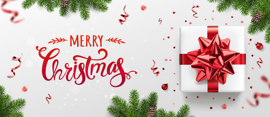 Fototapete - Merry Christmas card with holiday text, gift boxes, fir branches, red ribbons and bow, sparkles, confetti, bokeh on light background. Xmas and New Year holiday. Vector Illustration, realistic vector