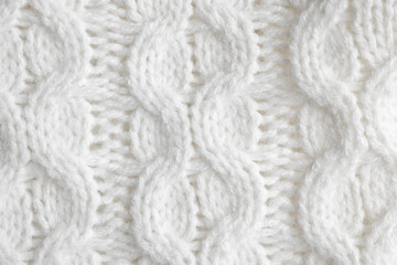 Fototapete - White knitted sweater as background, closeup view