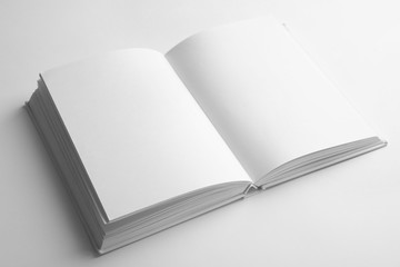 Open book with blank pages on white background. Mock up for design