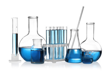 Fototapete - Set of laboratory glassware with blue liquid isolated on white