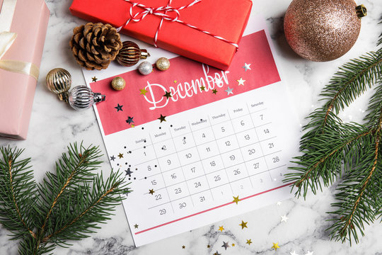 Flat lay composition with paper calendar on white marble table