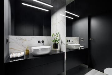 Black bathroom with mirror wall