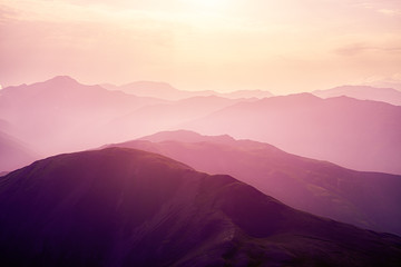 Pink sunset in the mountains. Wall mural