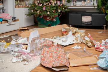 It is holy night. The gifts are unpacked. There is a mess of wrapping paper and boxes throughout the living room. Authentic picture from private party.