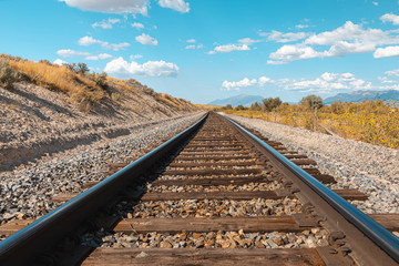 Tuinposter Spoorlijn Straight railroad track in Utah, USA - the way forward