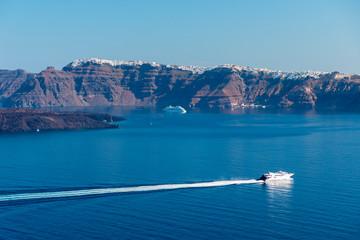 A cruise ship on the blue Aegean Sea near Santorini Island in the Greek Islands