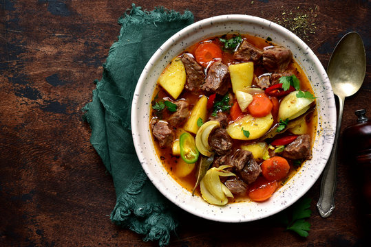 Beef stew with vegetables. Top view with copy space.