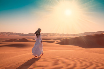 UAE. Woman in desert