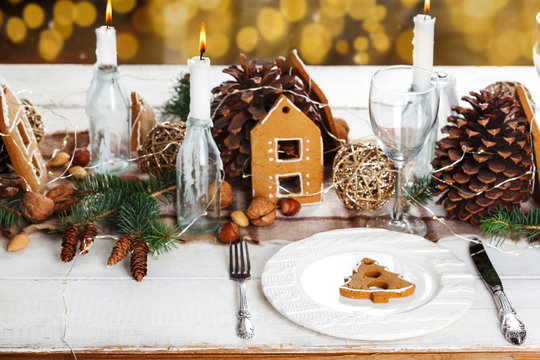 Christmas table setting with gingerbread. Holiday decoration