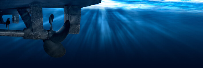 Twin propeller and rudder of big ship underway from underwater. Close up image detail of ship. Transportation industry. Freight transportation. Wall mural