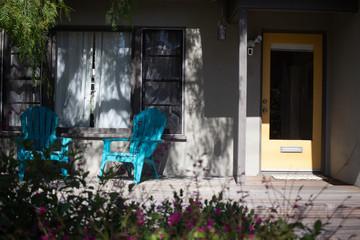 pleasant vacation rental house front porch with colorful blue chairs