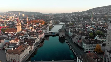 Fototapete - Aerial cityscape reveal video of Zurich and River Limmat at Sunrise, Switzerland