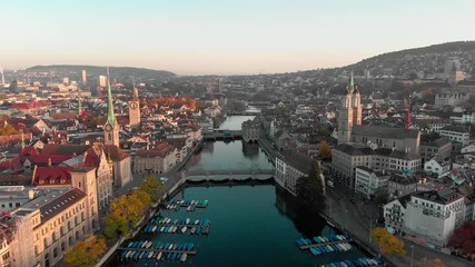 Fototapete - Aerial cityscape flythrough video of Zurich and River Limmat at Sunrise, Switzerland