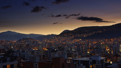 Panoramic view of the central area of the city of Quito during sunset with a clear sky - Ecuador