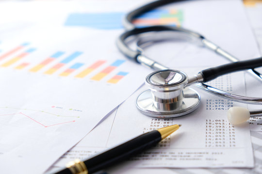 Stethoscope with Pen, Charts and Graphs, Finance, Account, Statistics, Investment, Analytic Research Data Economy Spreadsheet and Business Company Concept