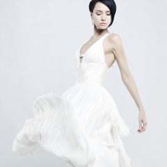 Poster womenART Beautiful young lady in a billowing white dress