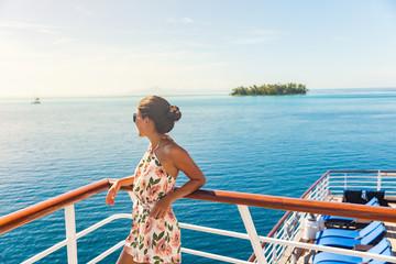 Cruise ship travel vacation woman looking at ocean from deck of sailing boat. Luxury Tahiti Bora Bora French Polynesia destination summer lifestyle. Wall mural