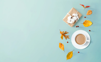 Wall Mural - Autumn theme with a cup of coffee and a gift box - overhead view