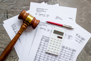 Bankruptcy concept. Judge hammer near financial documents on grey background top view