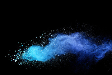 Blue sky color powder explosion on black background.