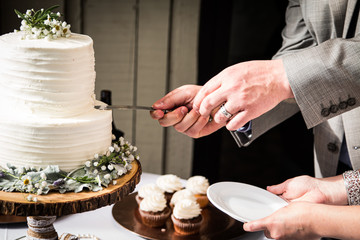 Serving the Cake at a Wedding
