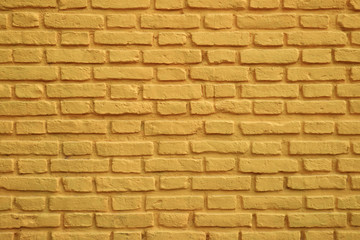 Old tuscany yellow colored brick wall for background and banner