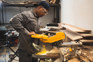 Professional technicians are using saws to cut wood.