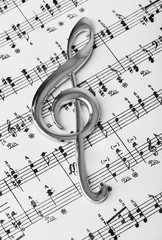 Wall Mural - Treble clef on music sheet - musical background