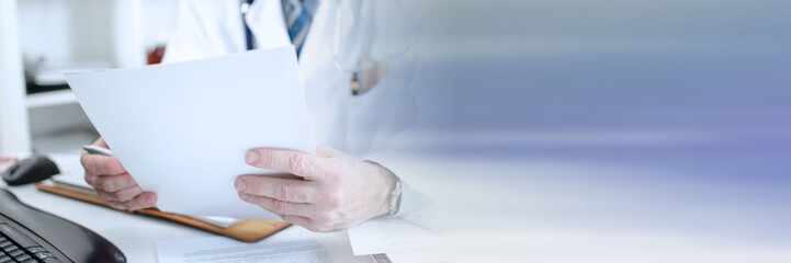 Doctor reading medical notes; panoramic banner