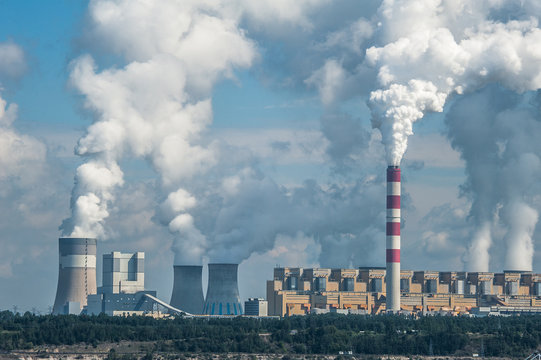 Power plant in Bełchatów, Poland. Coal-fired power station with steam billowing from high chimneys